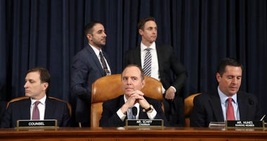Daniel Goldman (L), attorney and director of investigations with the House Intelligence Committee, and House Intelligence Committee Chairman Adam Schiff (C) (D-CA), and U.S. House Intelligence Committee ranking member Rep. Devin Nunes (R) (R-CA).
