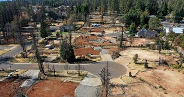 n aerial view of a neighborhood destroyed by the Camp Fire October 21, 2019 in Paradise.