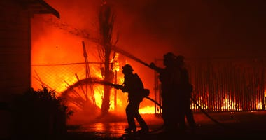 irefighters battle the Kincade Fire as it burns a barn on October 27, 2019 in Santa Rosa.