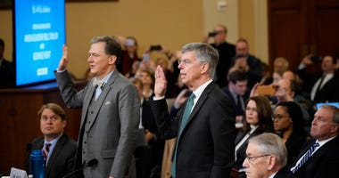 Top U.S. diplomat to Ukraine, William B. Taylor (R), and Deputy Assistant Secretary for European and Eurasian Affairs George P. Kent (L) are sworn in prior to providing testimony to the House Intelligence Committee on Nov. 13, 2019.