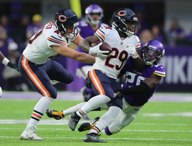 Tarik Cohen #29 of the Chicago Bears gets tackled by Mackensie Alexander #20 of the Minnesota Vikings in the first quarter at U.S. Bank Stadium on December 29, 2019 in Minneapolis, Minnesota.