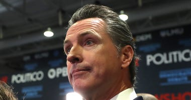 Governor Gavin Newsom walks through the spin room after the Democratic presidential primary debate at Loyola Marymount University on December 19, 2019 in Los Angeles.