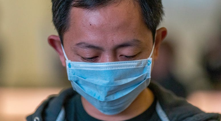 Travelers arrive to LAX Tom Bradley International Terminal wearing medical masks for protection against the novel coronavirus outbreak on February 2, 2020 in Los Angeles.
