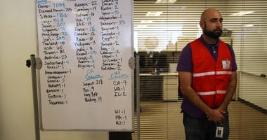 Narimon Mirza stands next a to a whiteboard showing the number of Coronavirus COVID-19 cases around the world at the Medical Health and Coordination Center at the California Department of Public Health on February 27, 2020 in Sacramento.