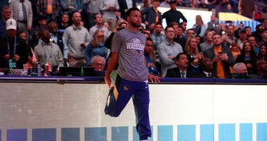 Stephen Curry #30 of the Golden State Warriors stretches before their game against the Toronto Raptors at Chase Center on March 05, 2020 in San Francisco.
