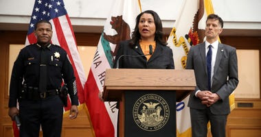 San Francisco Mayor London Breed (C) speaks during a press conference as San Francisco police chief William Scott (L) and San Francisco Department of Public Health director Dr. Grant Colfax (R) look on at San Francisco City Hall on March 16, 2020.