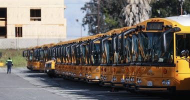 chool buses are parked in a lot, idled by the closing of schools in response to the novel coronavirus outbreak, on March 17, 2020 in Gardena, California.
