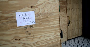 SAN FRANCISCO, CALIFORNIA - MARCH 20: A sign urging people to wash their hands is posted on plywood that is covering the windows of a business on Valencia Street on March 20, 2020 in San Francisco, California.