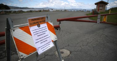 A closed sign is posted in front of a parking lot at China Camp State Park on March 25, 2020 in San Rafael.