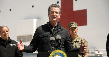 r Gavin Newsom speaks in front of the hospital ship USNS Mercy that arrived into the Port of Los Angeles on Friday, March 27, 2020.