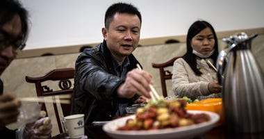 Guests eat crayfish at restaurant on April 10,2020 in Qianjiang, Hubei Hubei Province, China.
