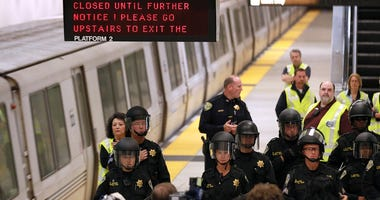 Bay Area Rapid Transit (BART) police officers stand on the platform at the Civic Center station after the station was closed due to a protest on August 22, 2011 in San Francisco, California.