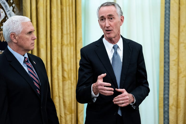 WASHINGTON, DC - MAY 1: U.S. Vice President Mike Pence listens to Gilead Sciences Chairman and CEO Daniel O'Day during an announcement that the Food and Drug Administration issued an emergency approval for the antiviral drug remdesivir in the Oval Office.