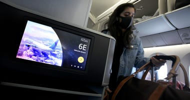 SAN FRANCISCO, CALIFORNIA - MAY 11: A passenger boards a United Airlines flight to Houston, Texas at San Francisco International Airport on May 11, 2020 in San Francisco, California.