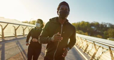 Runners in masks
