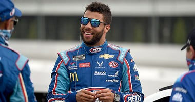 Bubba Wallace, driver of the #43 Victory Junction Chevrolet, waits on the grid prior to the NASCAR Cup Series Pocono Organics 325 in partnership with Rodale Institute at Pocono Raceway on June 27, 2020 in Long Pond, Pennsylvania.