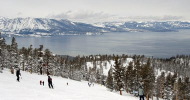 Skiers and snowboarders near Lake Tahoe.