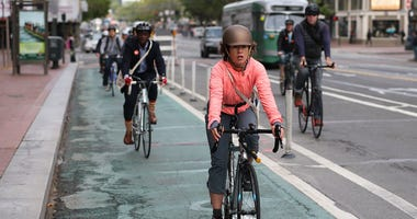 Bicyclists ride along Market Street on May 9, 2013 in San Francisco.