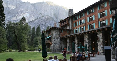 Park visitors sit outside of the Ahwahnee Hotel on August 28, 2013 in Yosemite National Park