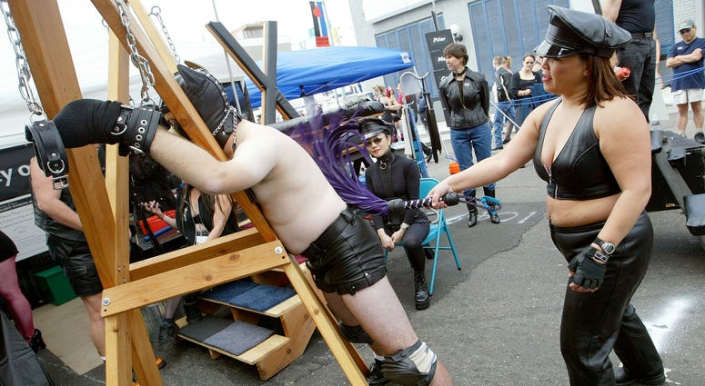 A man is whipped by a woman at the 20th Annual Folsom Street Fair September 28, 2003 in San Francisco, California.
