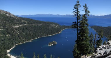 : Emerald Bay lies under blue skies at Lake Tahoe on July 23, 2014 near South Lake Tahoe, California.