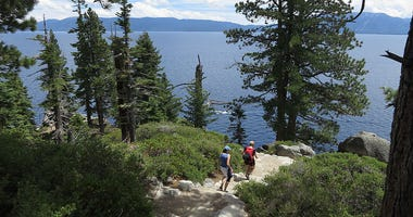 Visitors hike through DL Bliss State Park at Lake Tahoe
