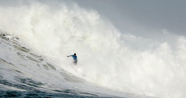 eter Mel rides a wave during the second heat of round one of Mavericks Invitational on January 24, 2014 in Half Moon Bay, California.