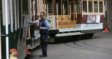 Cable Cars sit idle at the historic Cable Car Barn and Powerhouse on June 3, 2014 in San Francisco, California.