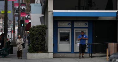 Pedestrians walk by a Chase Bank branch on January 18, 2017 in Los Angeles.
