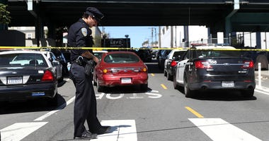 A San Francisco police officer stands guard at the scene of a shooting at a company facility on June 14, 2017 in San Francisco, California.