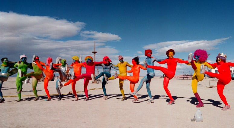 "e ""Painted People"" of San Francisco and New York, dance while wearing only paint for clothing September 2, 2000 at the15th annual Burning Man festival in the Black Rock Desert near Gerlach, Nevada."