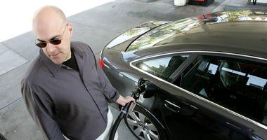A customer pumps gasoline into his car at a service station May 7, 2007 in San Francisco, California.