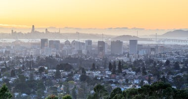 San Francisco and Oakland at sunset.