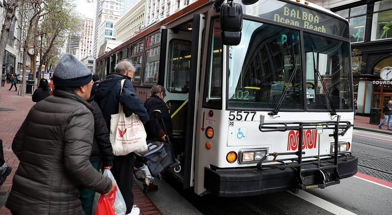 assengers board a MUNI bus on March 21, 2018 in San Francisco, California.