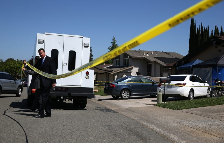 Law enforcement officials leave the home of accused rapist and killer Joseph James DeAngelo on April 24, 2018 in Citrus Heights, California.