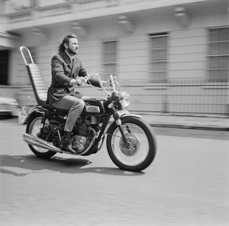 Australian actor and former model George Lazenby on his motorcycle, UK, 27th July 1970.