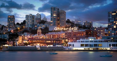 The iconic Ghirardelli sign lights up the waterfront in San Francisco.