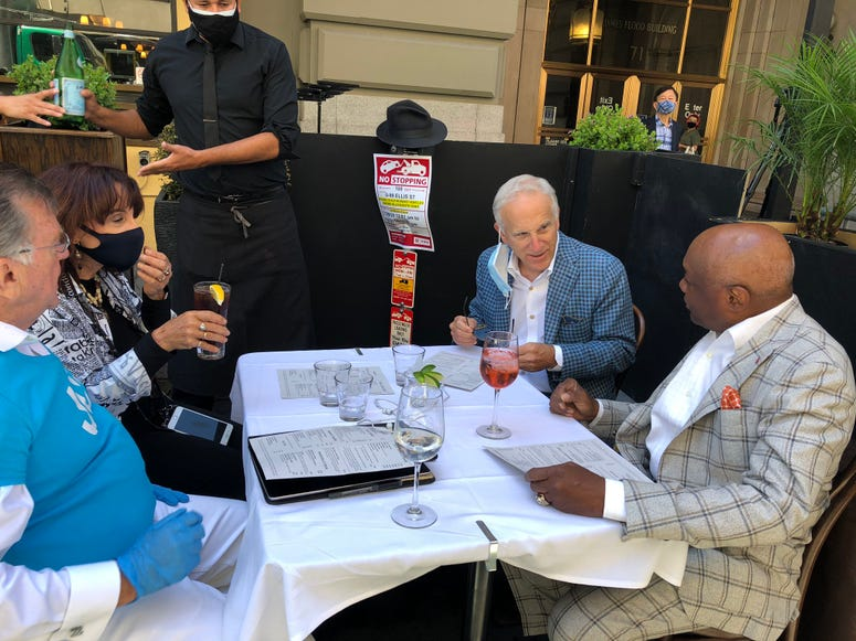 Former San Francisco Mayor Willie Brown and friends on the first day of reopening at John's Grill on Ellis St.