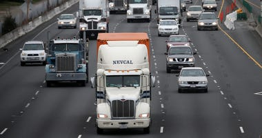 Trucks drive along Interstate 80 on February 18, 2014 in Berkeley, California.