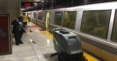 Crews clear water on BART platform at Embarcadero Station July 18, 2019