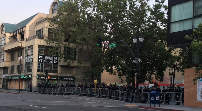 Oakland Police Officers lined up at 8th and Broadway in anticipation of George Floyd and curfew Protesters, June 3, 2020