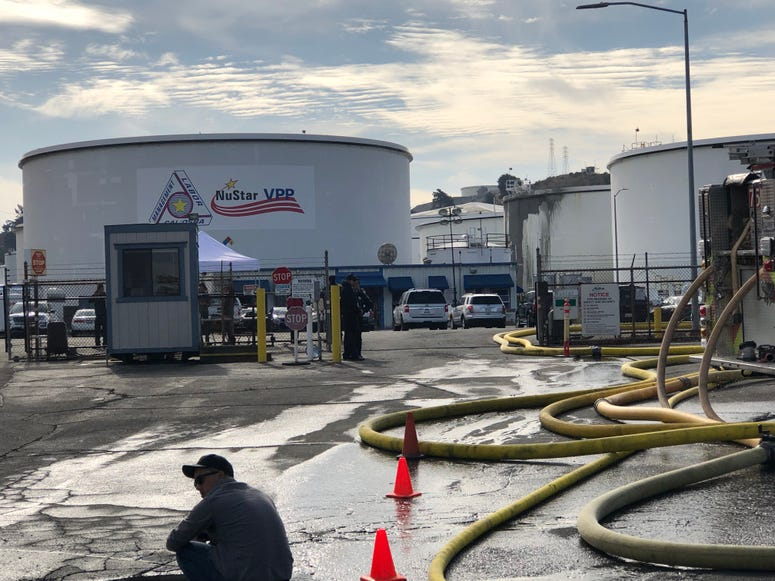 A day after the two fuel tanks were destroyed in a fire, workers were trying to remove leftover ethanol from the plant in Crockett before an investigation could begin on Oct. 16, 2019.