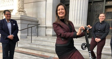 Oakland Mayor Libby Schaaf on Jan. 8, 2020 models an electronic scooter that has been designed for people with disabilities.