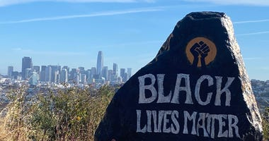 """The Bernal Heights rock has """"Black Lives Matter"""" painted on it once again."""