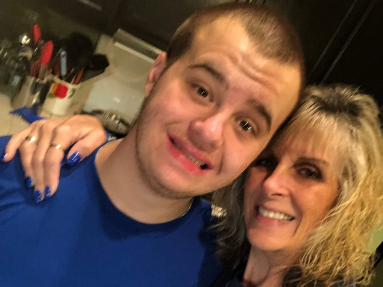 Lisa McBride and her 19-year-old son, Jake. The Discovery Bay mom had a confrontation with her homeowners association over the blue lights she hangs outside of her house for autism awareness month in April.