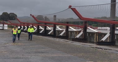 Workers are building an anti-suicide barrier that will be installed beneath the Golden Gate Bridge.