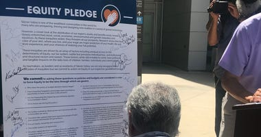 One by one, South Bay mayors, school board members, community leaders and lawmakers walked up to sign the pledge.