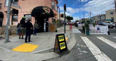 Customers line up at Cafe Envy on the first day San Francisco restaurants were allowed to reopen for outdoor dining.