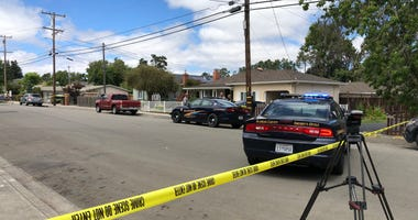 Police tape surrounds the site of two discovered bodies in a Castro Valley home on June 26, 2019.