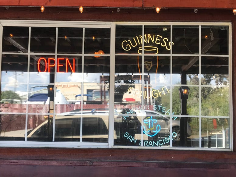 St. James Gate in Belmont continued serving beer and food in its barroom on March 20, 2020 despite the statewide shelter in place order.